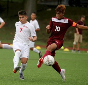 Alessio Hernandez of Ossining battles Ketcham's Gionvanni Perdomo during a varsity soccer game at Ossining High School Sept. 12, 2018. Ossining defeated Ketcham 5-2.
