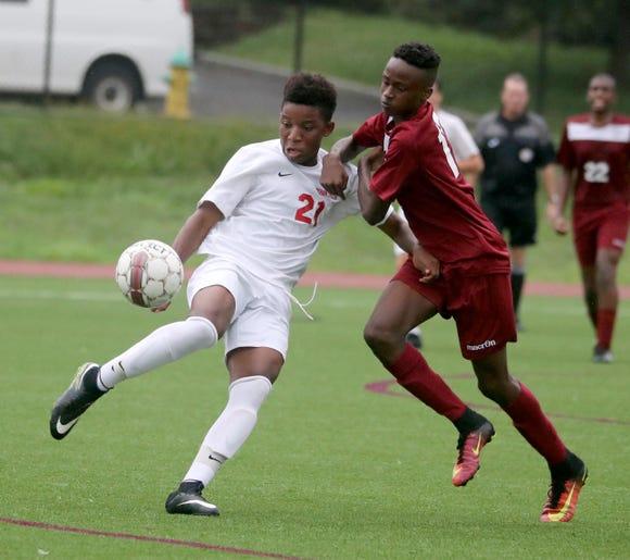 Emmanuel Arubuike of Ketcham battles Tendai Nyoni of Ossining at Ossining High School Sept. 12, 2018. Ossining defeated Ketcham 5-2.