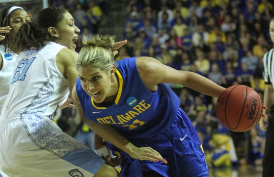 Elena Delle Donne drives past North Carolina forward Krista Gross in UD's 2013 NCAA tourney win.