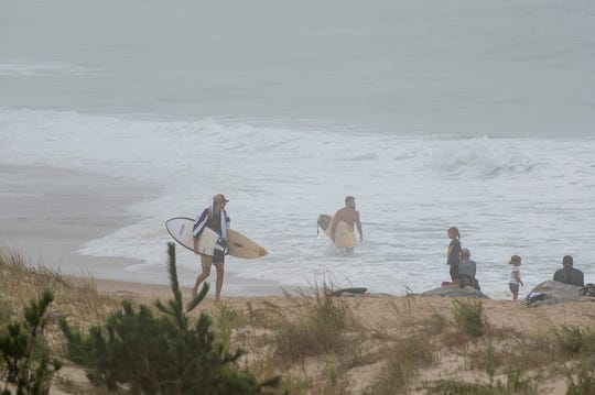 Surfers at Herring Point at Cape Henlopen State Park in Lewes.