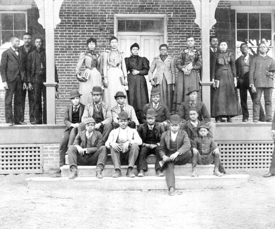 Students on the porch of Loockerman Hall in the late 1890s.