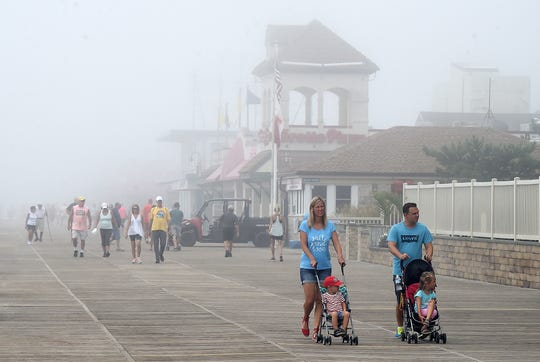 Foggy weather conditions at Rehoboth Beach have limited visitors on the beach and boardwalk as some prep is being done to ready for possible storm effects from Hurricane Florence.  Special to the News Journal / CHUCK SNYDER