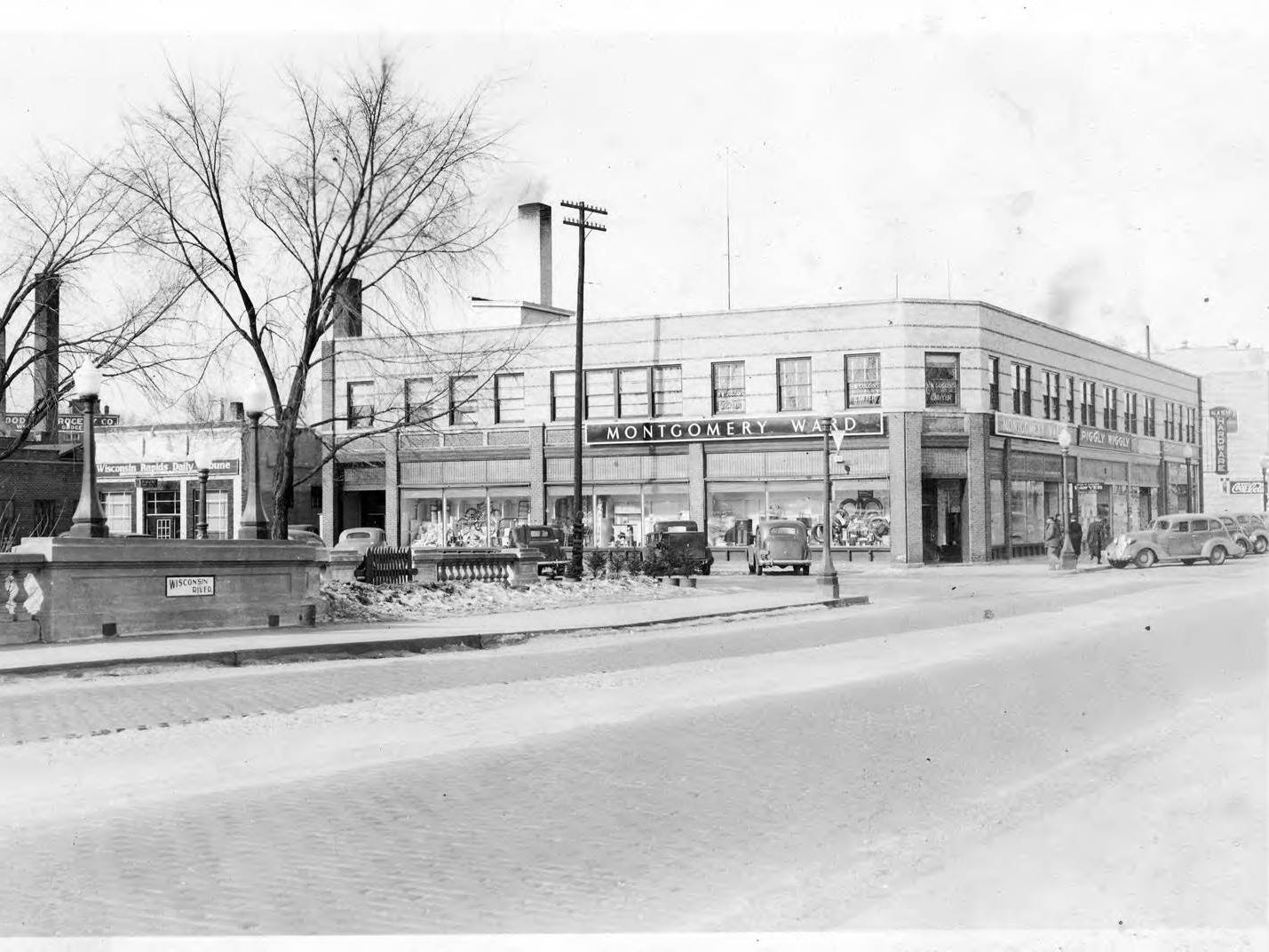 Montgomery Ward and the Piggly Wiggly can be seen from West Grand Avenue in 1937.