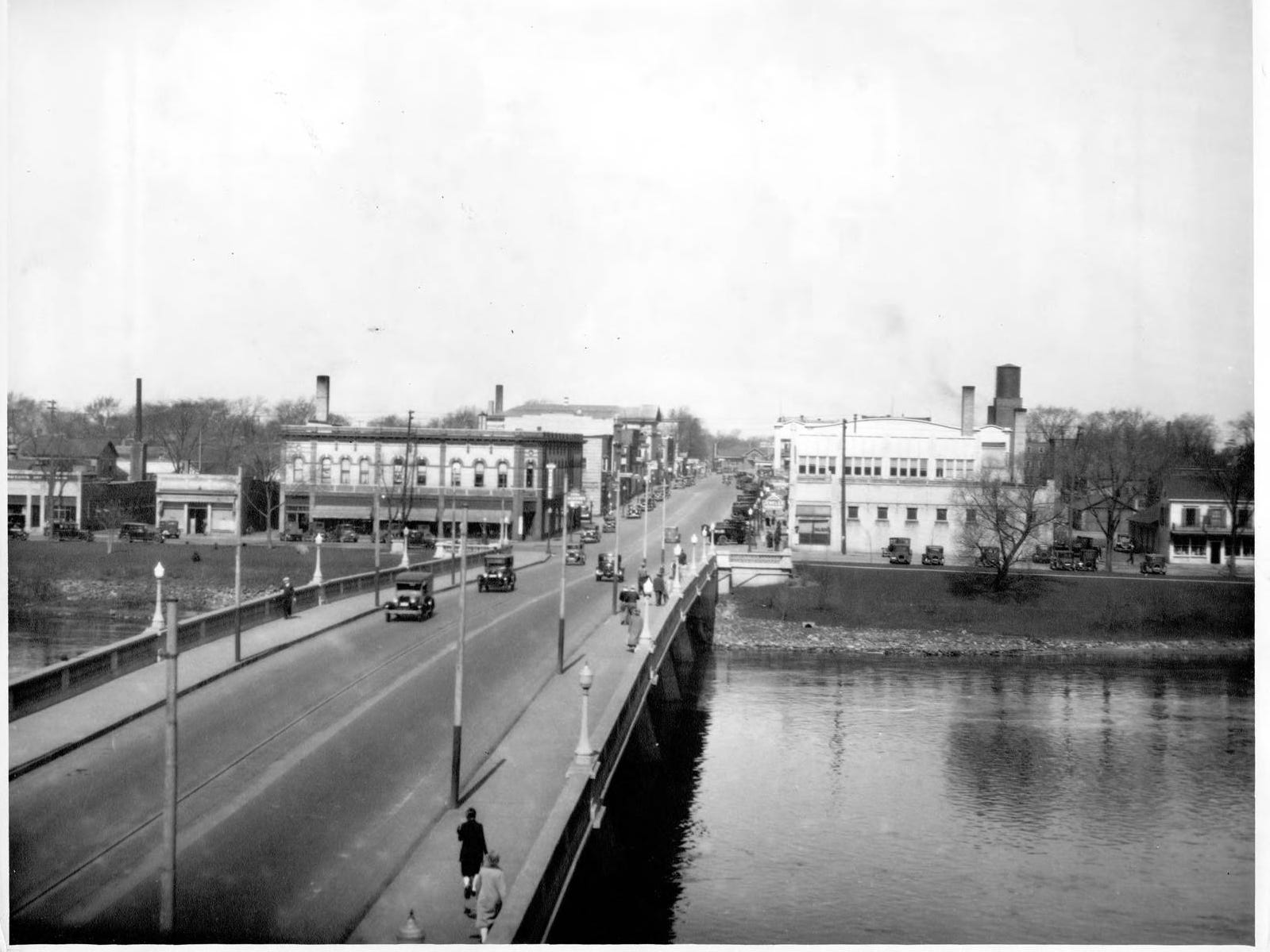The Nash and River blocks can be seen from this photo over the Grand Avenue bridge. The Mead-Witter Block building rises above the River Block on the right side of the bridge.