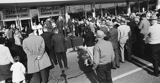 A crowd gathers around Woolco Department Stores. The store opened in 1965 in Wisconsin Rapids.