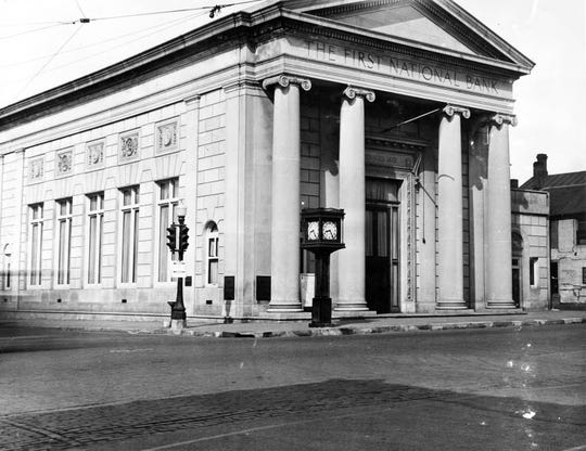 J. D. Witter founded the First National Bank in 1872. The building on West Grand Avenue was built in 1919.