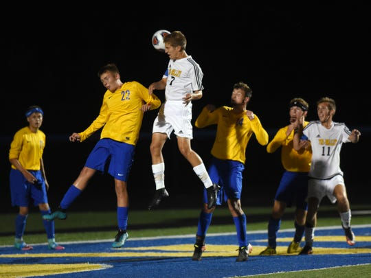 Tri-Valley's Parker Dinan heads the ball during a 3-0 win against Maysville last season. Dinan is one of several graduates for the Scotties, who have new faces on the sideline and in the lineup.
