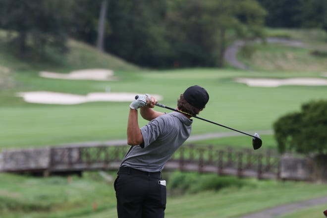 Tri-Valley's Drew Johnson hits a tee shot during Wednesday's match between Tri-Valley, John Glenn and Zanesville at Zanesville Country Club.