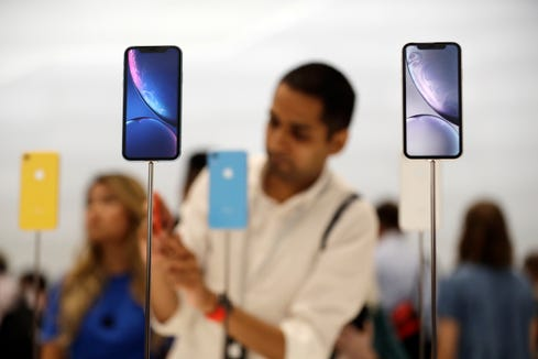 The new iPhone XR is displayed at Apple headquarters during an event to announce new products Wednesday, Sept. 12, 2018, in Cupertino, Calif.