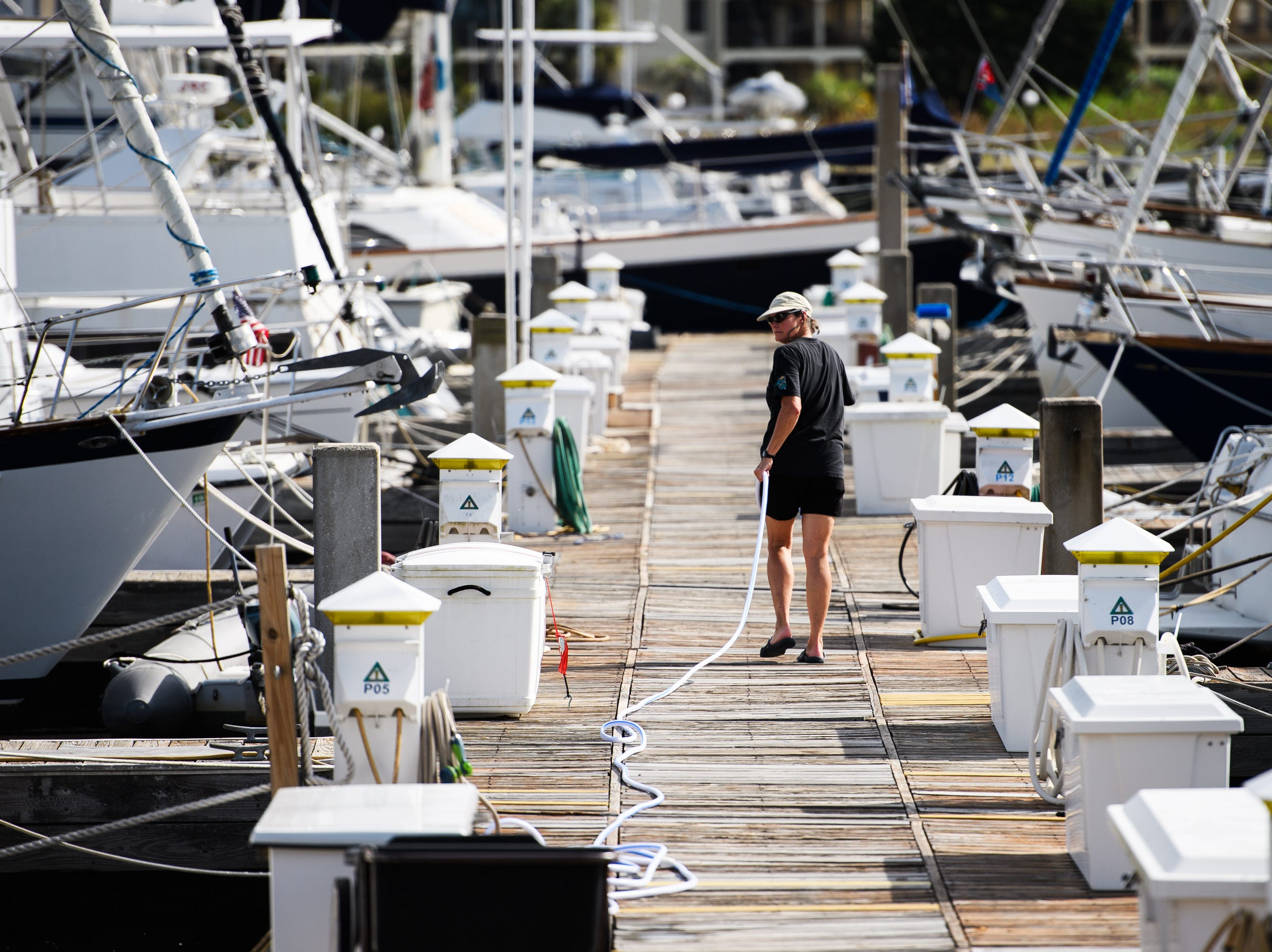 Barbara Coates finishes preparing her boat for Hurricane Florence at the Lightkeepers Marina in North Myrtle Beach on Wednesday, Sept. 12, 2018.