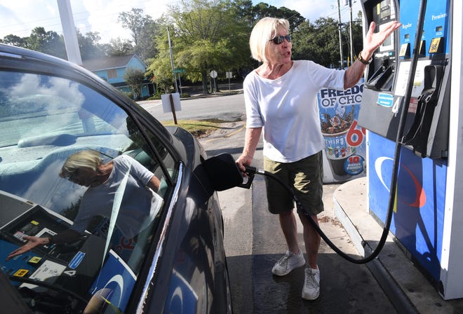 Wilmington, North Carolina, resident Margie Garrabrand tops off her gas tank on Wednesday, Sept. 12, 2018, at a Carolina Petro station as Hurricane Florence approaches.