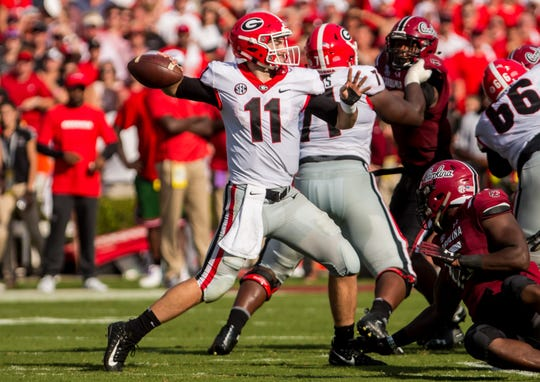 Georgia quarterback Jake Fromm looks to throw a pass against South Carolina during their team's game in 2018.