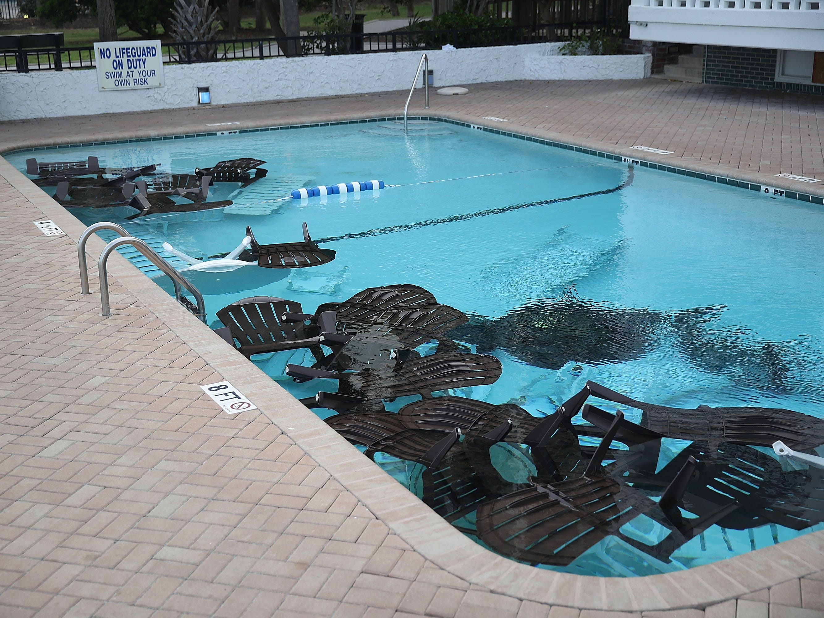 Patio furniture is seen in the pool in an effort to keep it from flying away as people prepare ahead of the arrival of Hurricane Florence on Sept. 12, 2018 in Myrtle Beach, S.C.