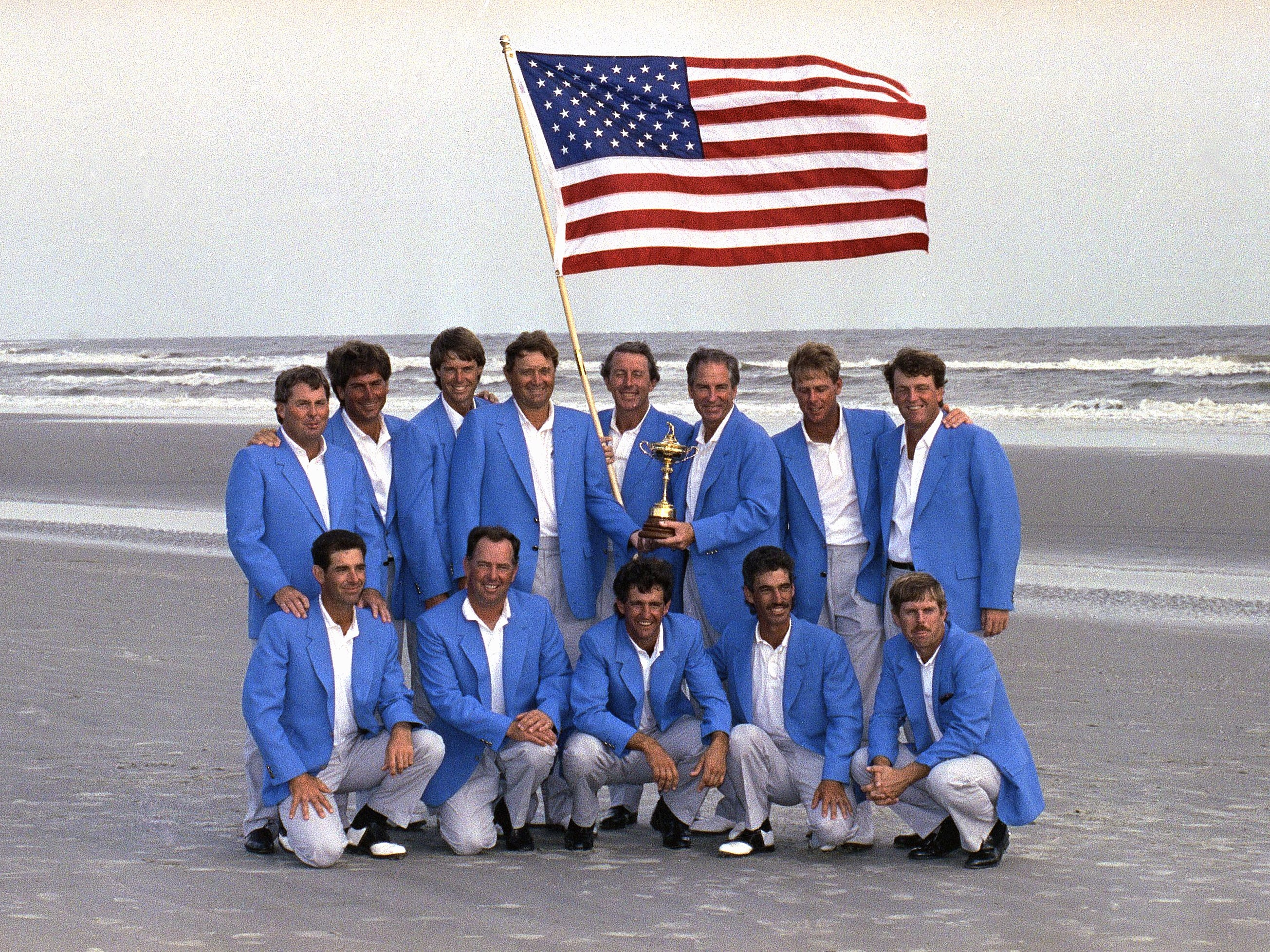 Team USA, 1991: The team poses with the American flag on the beach after defeating Team Europe 14.5-13.5.