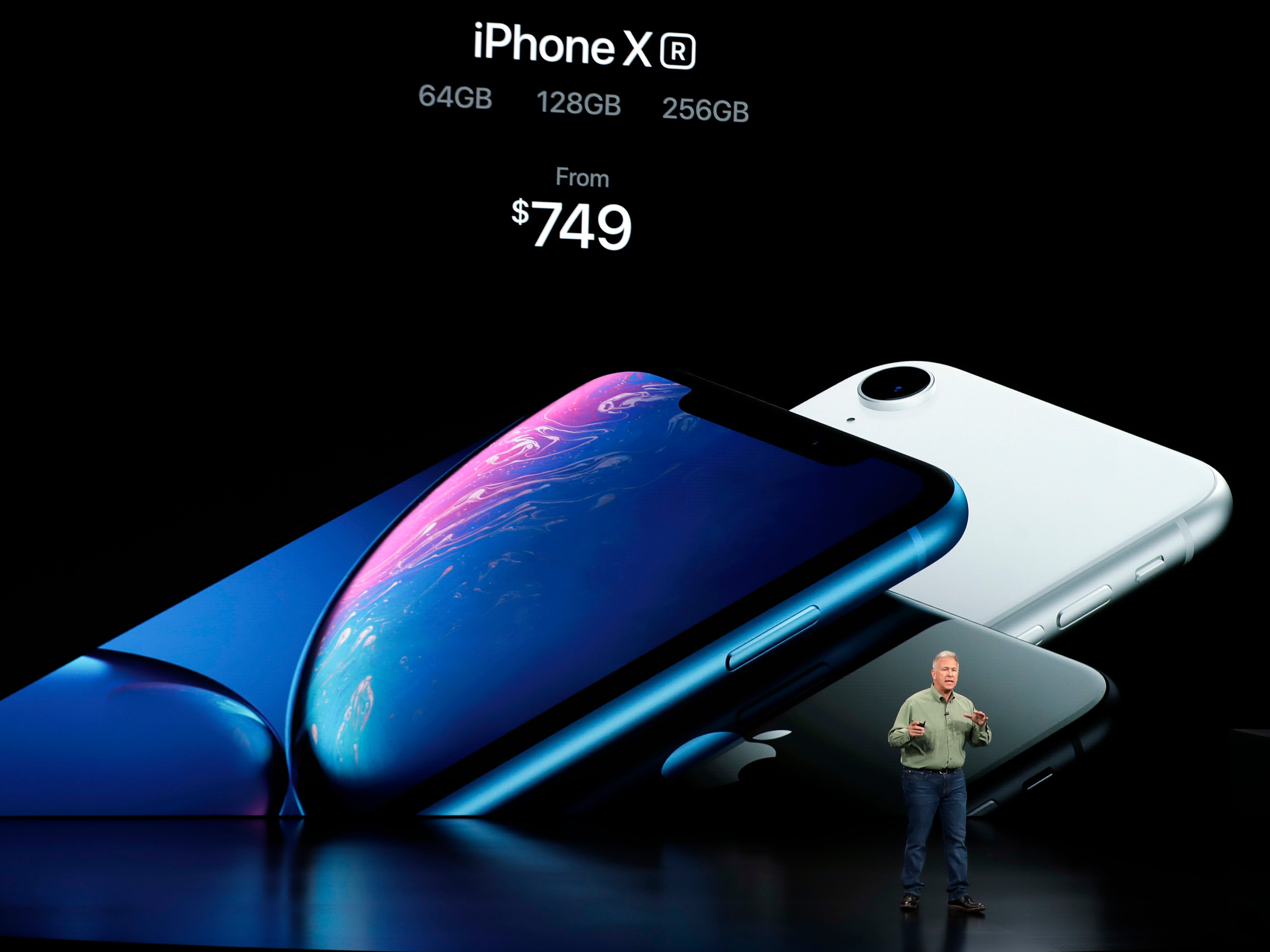 Phil Schiller, Apple's senior vice president of worldwide marketing, speaks about the new Apple iPhone XR at the Steve Jobs Theater during an event to announce new Apple products Wednesday, Sept. 12, 2018, in Cupertino, Calif.