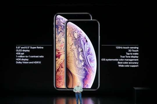 Phil Schiller from Apple showing the specs difference between upgraded iPhone XS and larger iPhone XS Max.