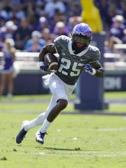 TCU wide receiver KaVontae Turpin carries the ball after making a catch.