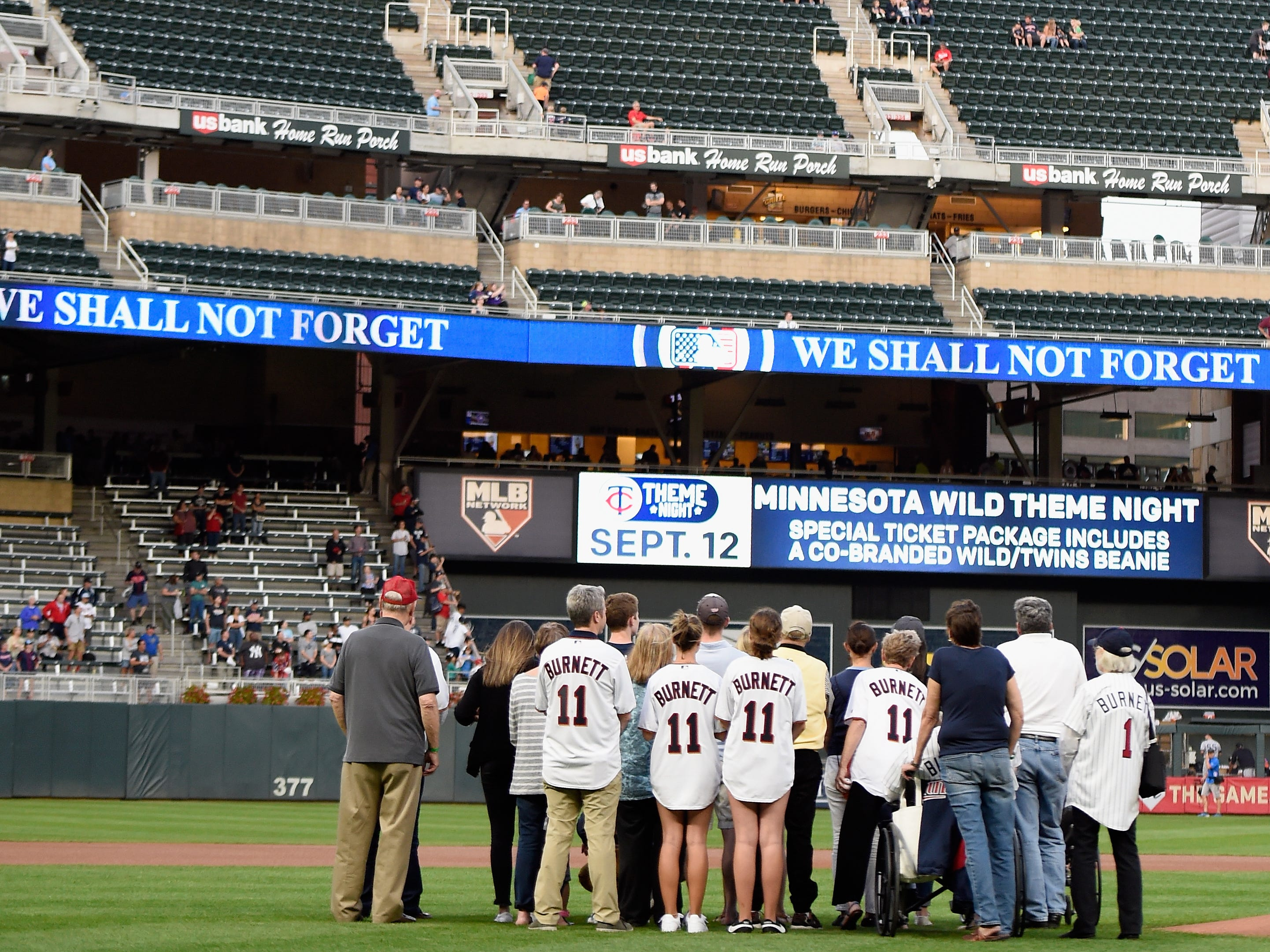 The family of United flight 93 passenger Tom Burnett watch a memorial video at Target Field in Minneapolis.