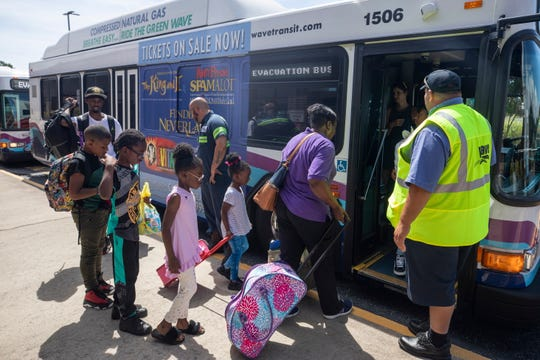 Families board evacuation buses for a shelter in Raleigh, North Carolina less than two days before Hurricane Florence is expected to strike Wilmington, N.C. on Sept. 12, 2018. According to reports, hurricane Florence has weakened to a category 3 storm on the Saffir-Simpson Hurricane Wind Scale, with winds toping 125 miles per hour.