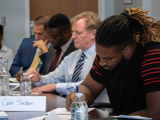 From left, Daniel Engelberg, chief of trials at the Orleans Public Defender, New Orleans Saints tight end Benjamin Watson, NFL Commissioner Roger Goodell and Saints defensive end Cam Jordan listen and take notes as the problems cash bail can create are explained Tuesday during a 'Listen and Learn' session organized by the Players Coalition.