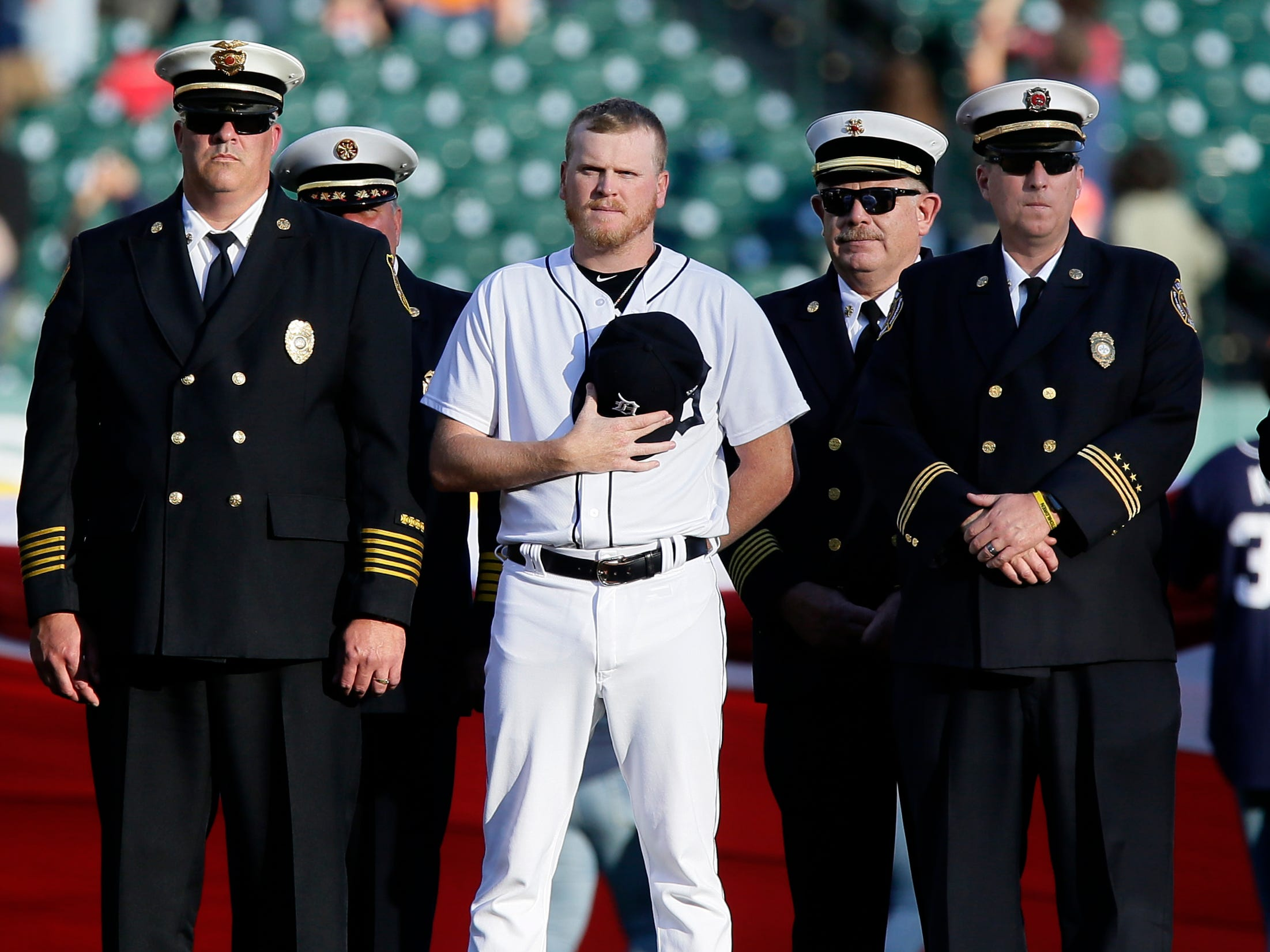 Daniel Stumpf of the Detroit Tigers stands with first responders.