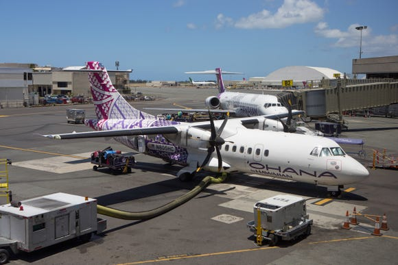 An Ohana ATR turboprop awaits its next load of passengers in warm Honolulu, Hawaii on June 3, 2018.