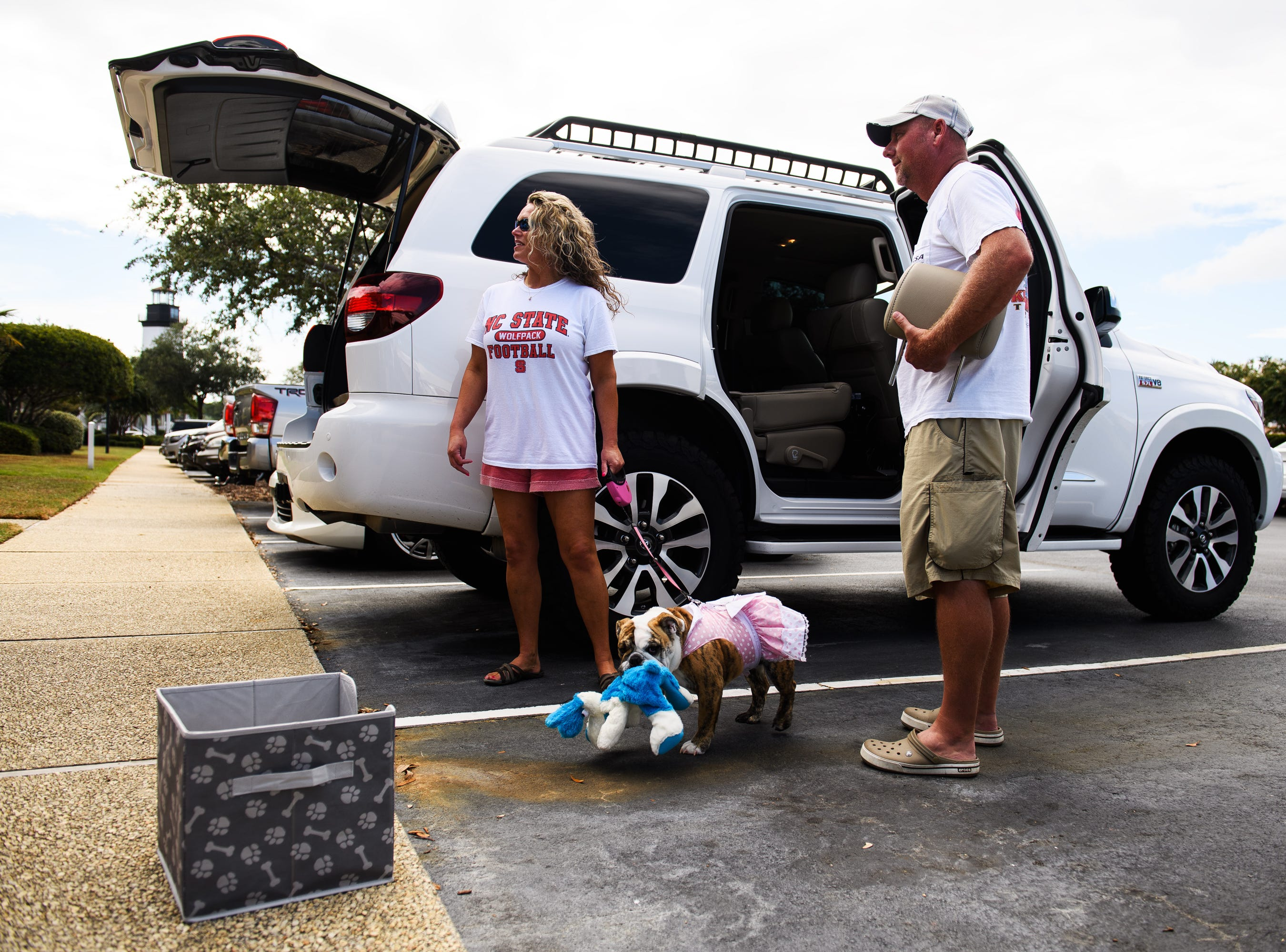 Billy and Stacy Prince and their dog Pixie begin packing up their vehicles to evacuate their North Myrtle Beach home on Wednesday, Sept. 12, 2018. Billy Prince, who grew up in the area, said he stayed for past hurricanes but didn't want to take the risk with Hurricane Florence.