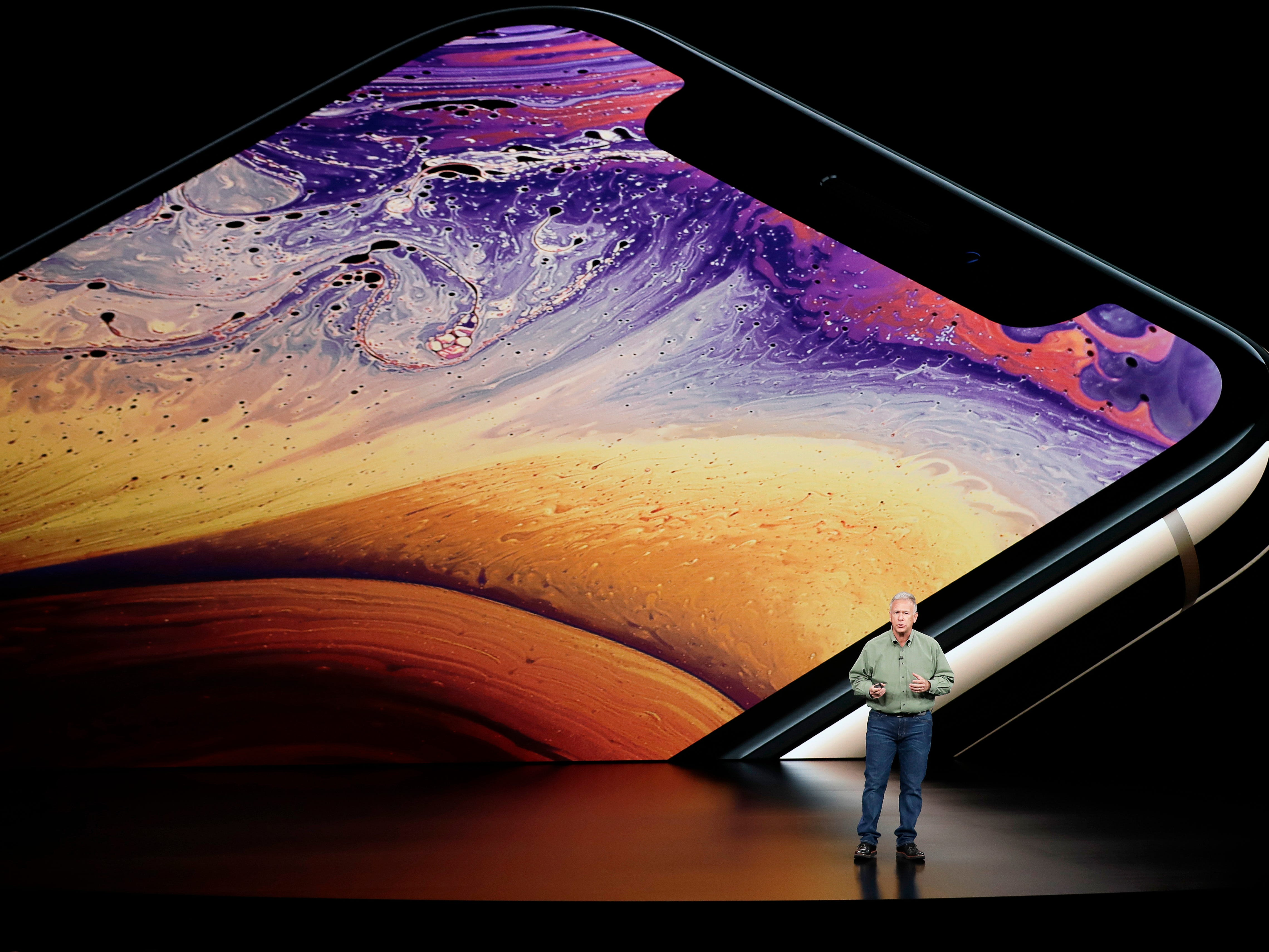 Phil Schiller, Apple's senior vice president of worldwide marketing, speaks about the Apple iPhone XS at the Steve Jobs Theater during an event to announce new Apple products Wednesday, Sept. 12, 2018, in Cupertino, Calif.