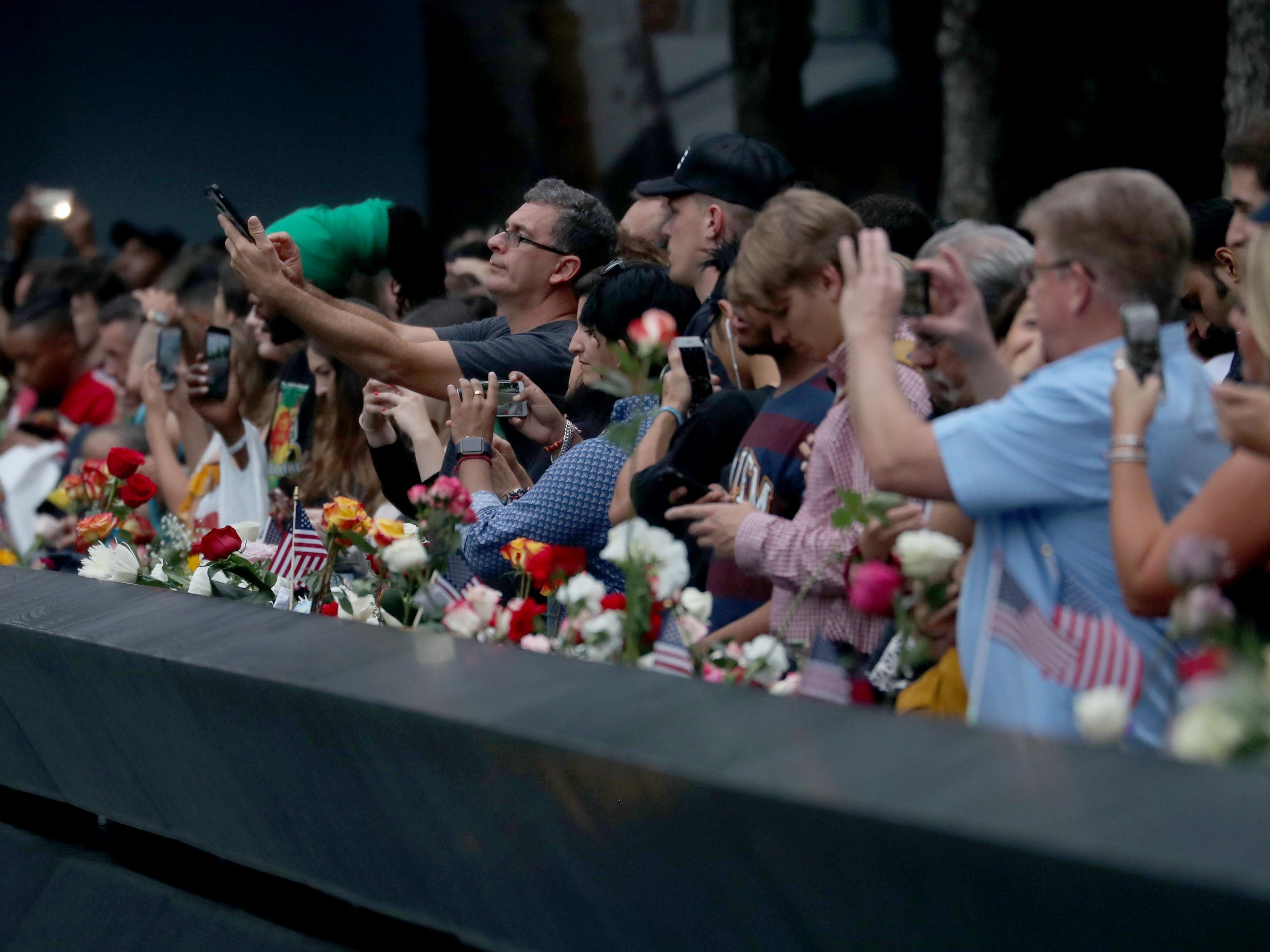 Thousands spend time at the The National September 11 Memorial in New York on Sept. 11, 2018.