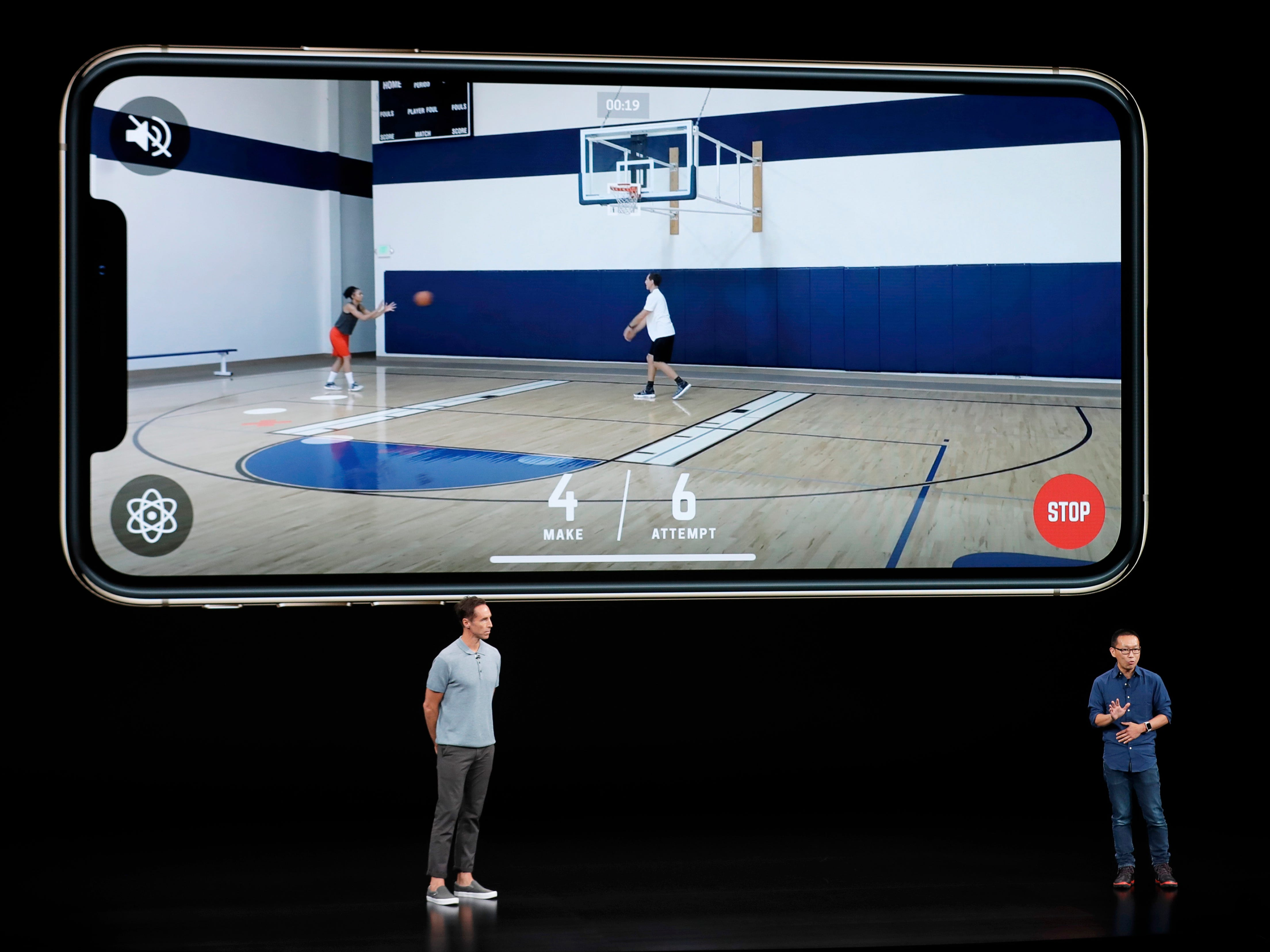 CEO and founder of HomeCourt, David Lee, right, and former NBA player Steve Nash talk about the Apple iPhone XS at the Steve Jobs Theater during an event to announce new Apple products Wednesday, Sept. 12, 2018, in Cupertino, Calif.
