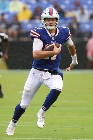 Buffalo Bills quarterback Josh Allen (17) runs for a gain against the Baltimore Ravens at M&T Bank Stadium.