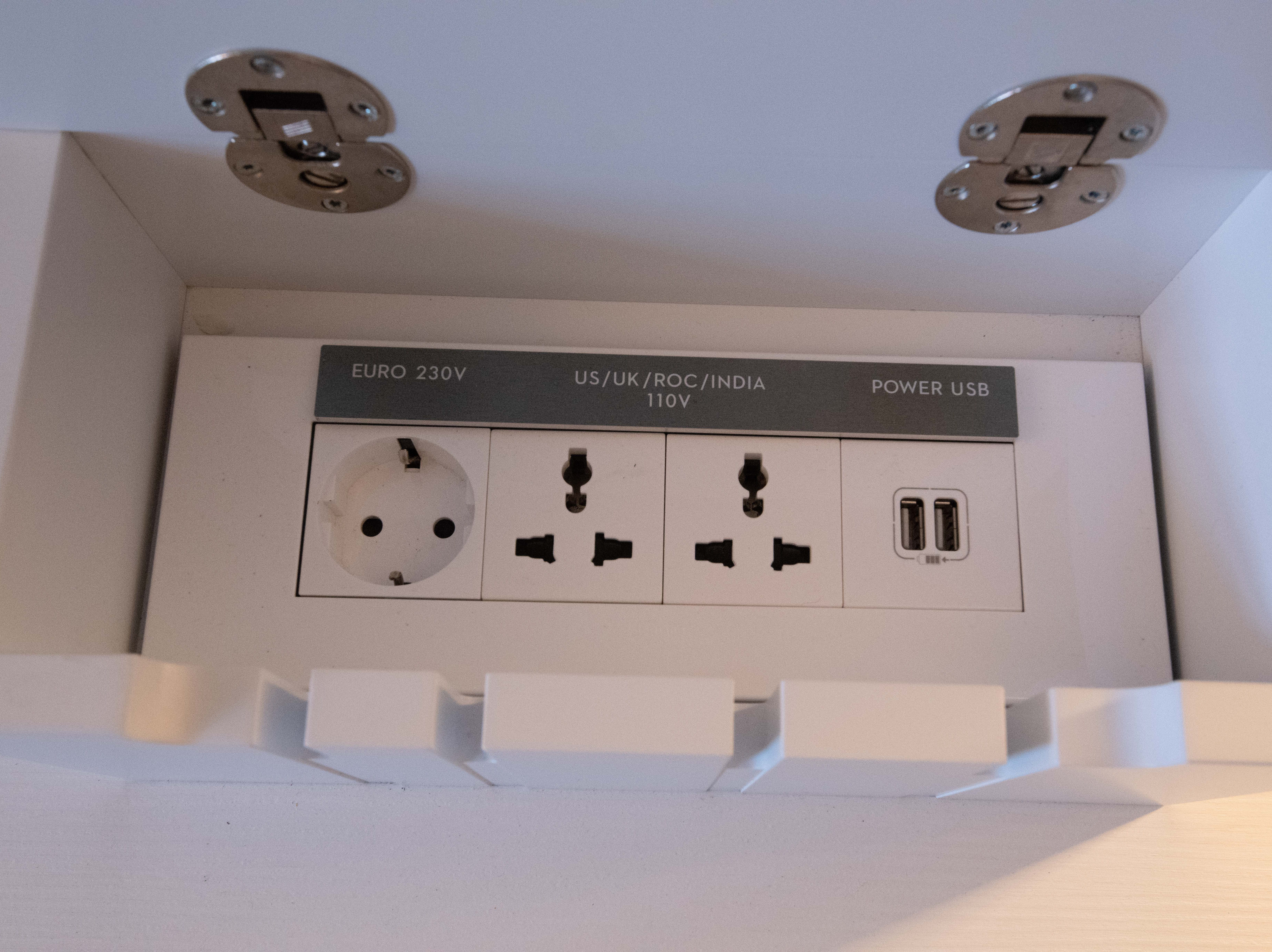 The built-in box with that hides away electrical outlets features both U.S.- and European-style outlets.