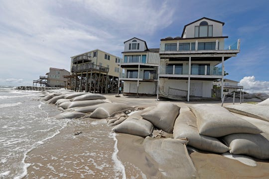 Sand bags surrounded homes on North Topsail Beach, North Carolina, on Wednesday.
