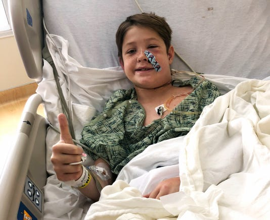 Ap Boy Impaled Meat Skewer A Usa Ks