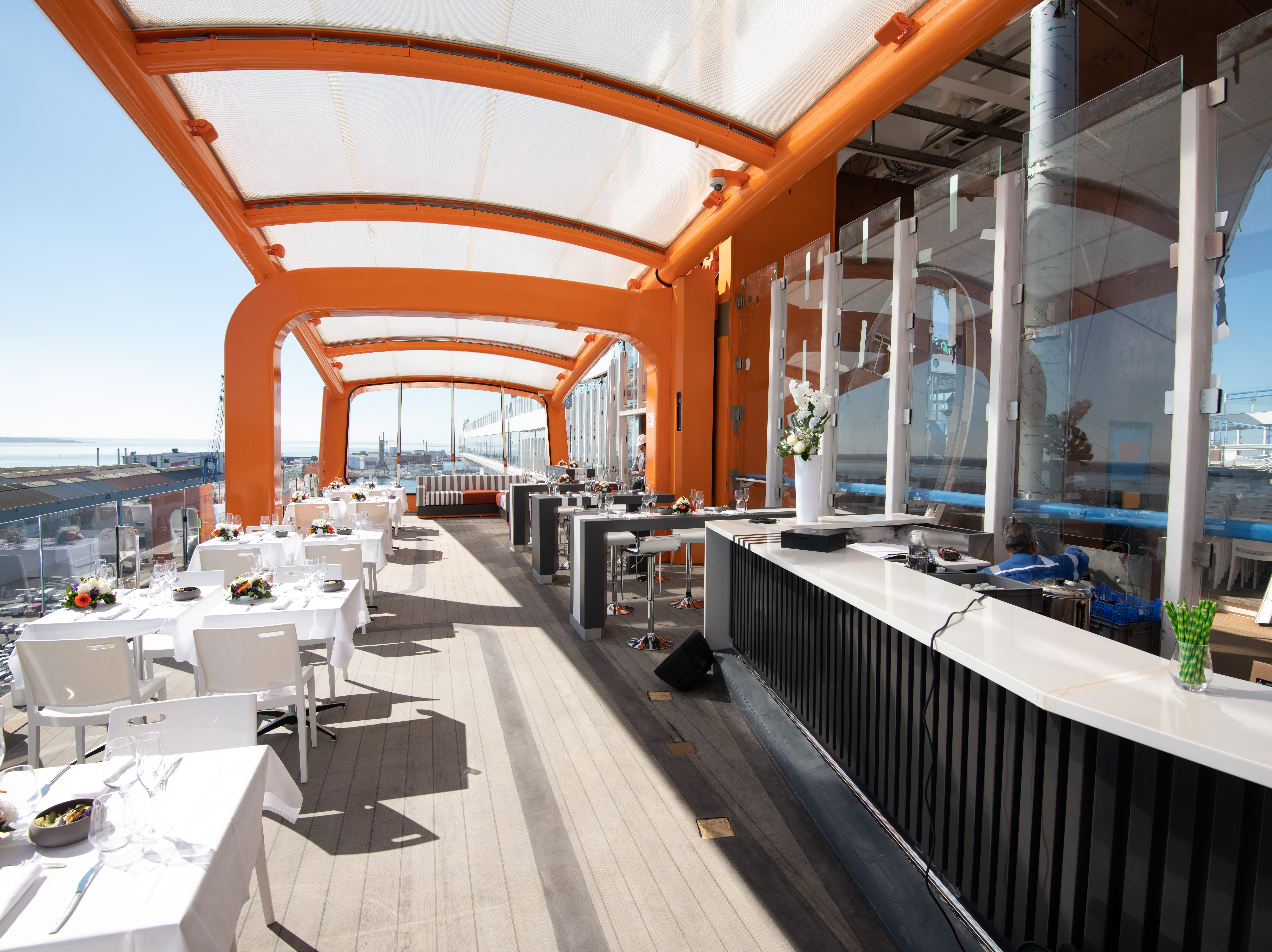 Perched on the starboard side of Celebrity Edge, the Magic Carpet platform has a a permanent, built-in bar facing out to the sea.