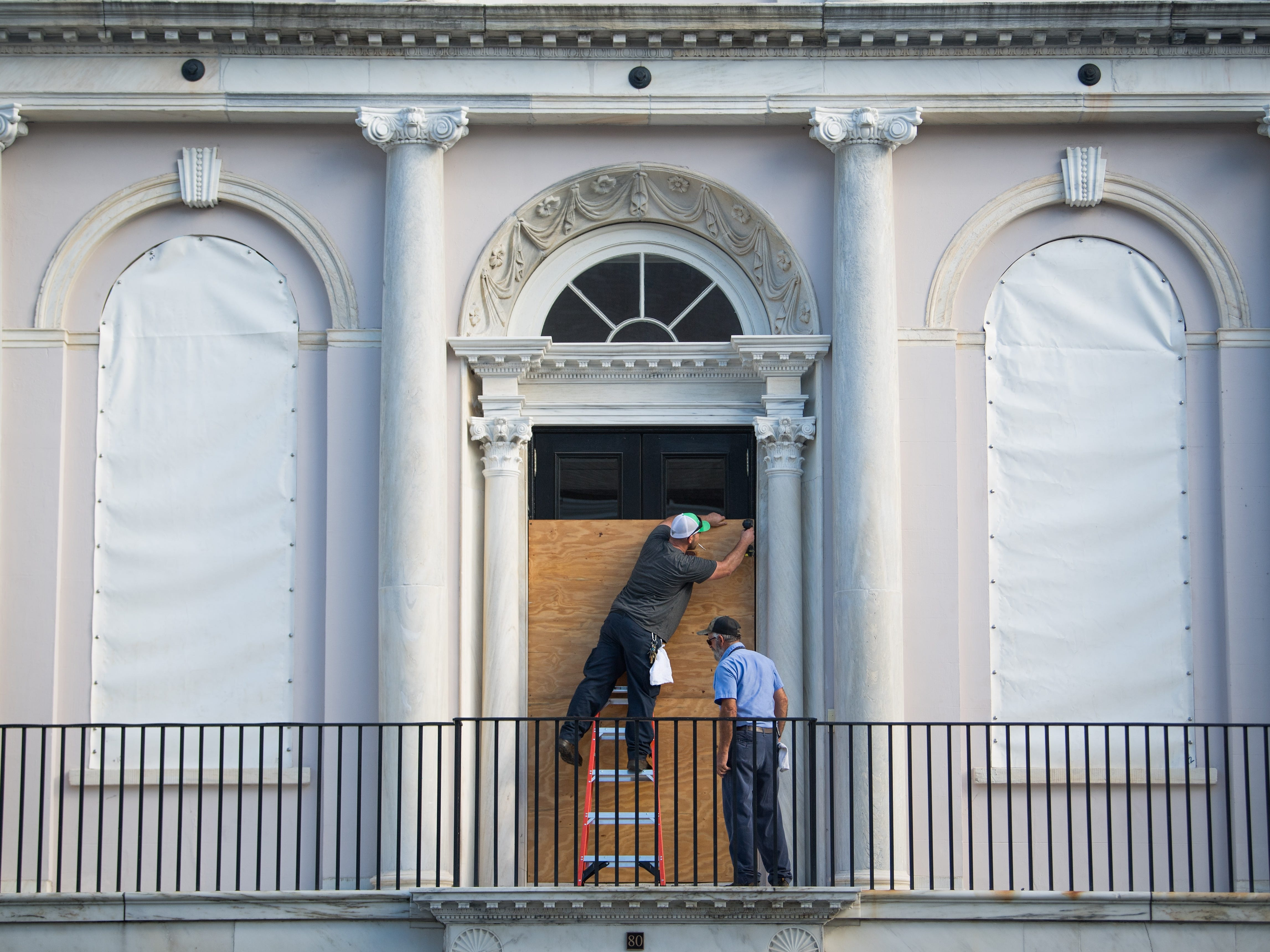 9/12/18 8:54:42 AM -- Charleston, NC, U.S.A  -- Workers prepare Charleston City Hall for the coming storm before Hurricane Florence makes landfall along the East Coast.