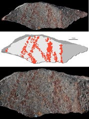 A rock displays a drawing made up of nine lines traced on one of its faces with an ochre implement. The middle image more clearly shows the pattern that was drawn on the rock.
