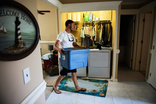 Jesse Prince packs up necessities as he prepares to evacuate his home in North Myrtle Beach to Florida in anticipation of Hurricane Florence on Sept. 12, 2018.