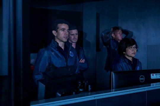 "Matteo Vega (Rey Lucas), Nick Fletcher (James Ransone) and Jennifer Aiko Hakari (Keiko Agena) in ""The First."""