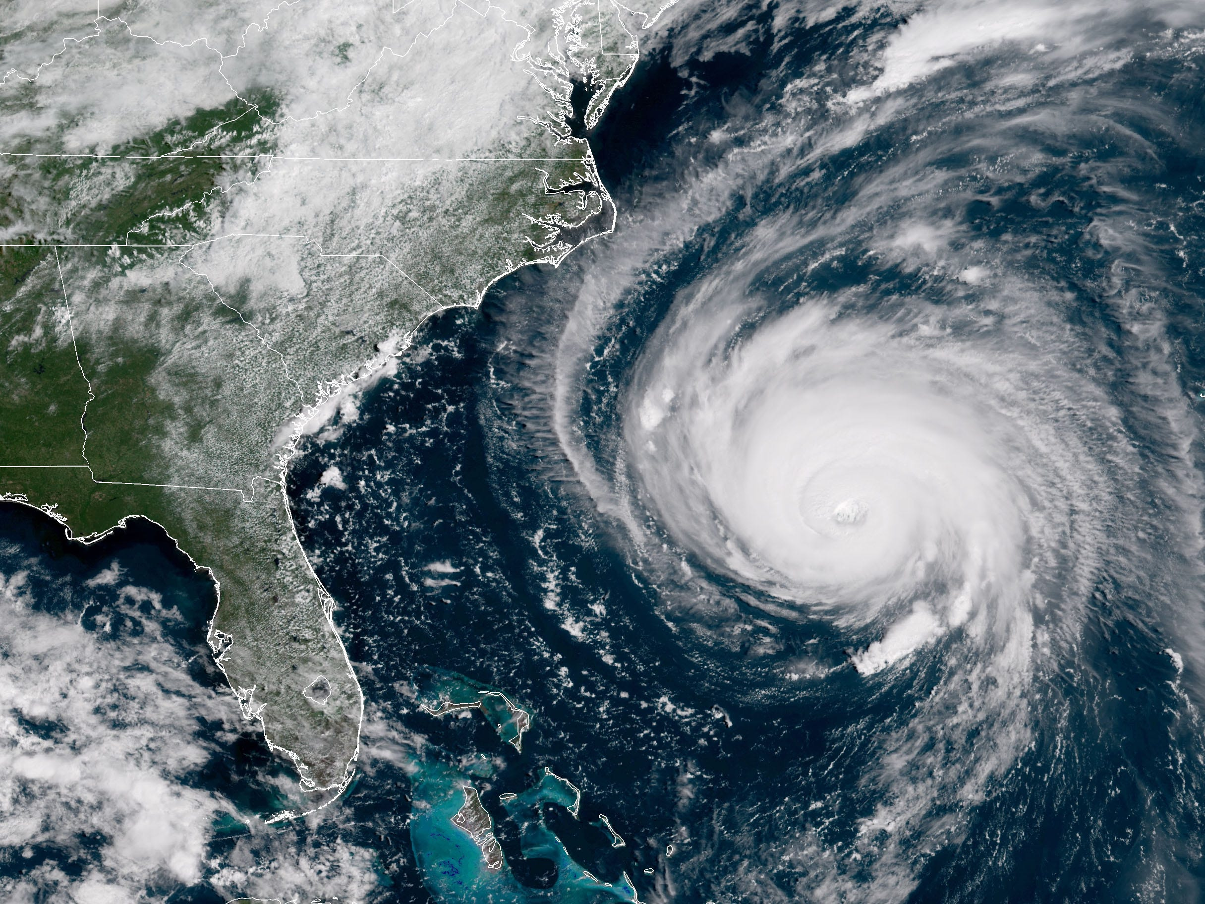 In this satellite image provided by the National Oceanic and Atmospheric Administration, Hurricane Florence churns through the Atlantic Ocean toward the East Coast on Sept. 12, 2018.