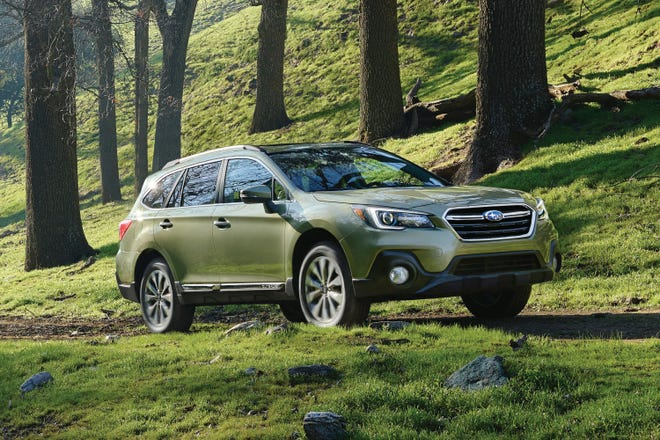 This undated photo provided by Subaru of America shows the 2018 Subaru Outback, a vehicle that carries a zero percent financing offer in September. Many automakers are dropping their zero percent offers, which are becoming more expensive to provide to buyers because of rising interest rates. (Courtesy of Subaru of America via AP)