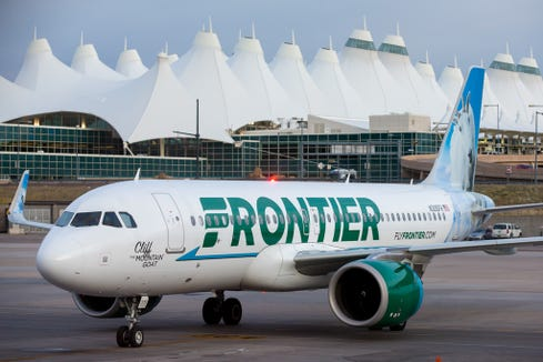A Frontier Airbus A320neo pulls into a gate at Denver International Airport in May 2017.