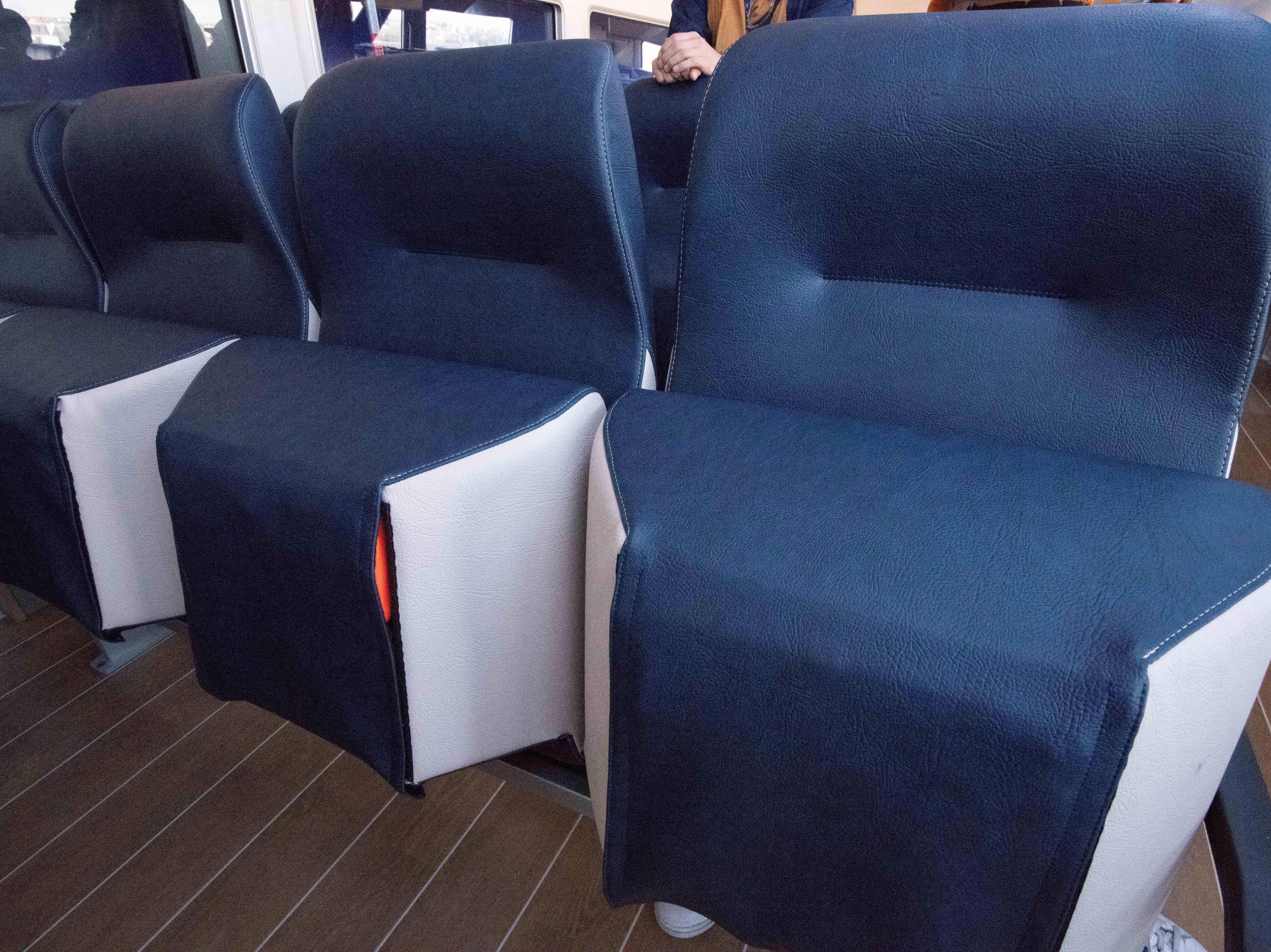 The bottoms of the cushioned seats in Celebrity Edge's tenders hide life jackets. The tenders will double as lifeboats.