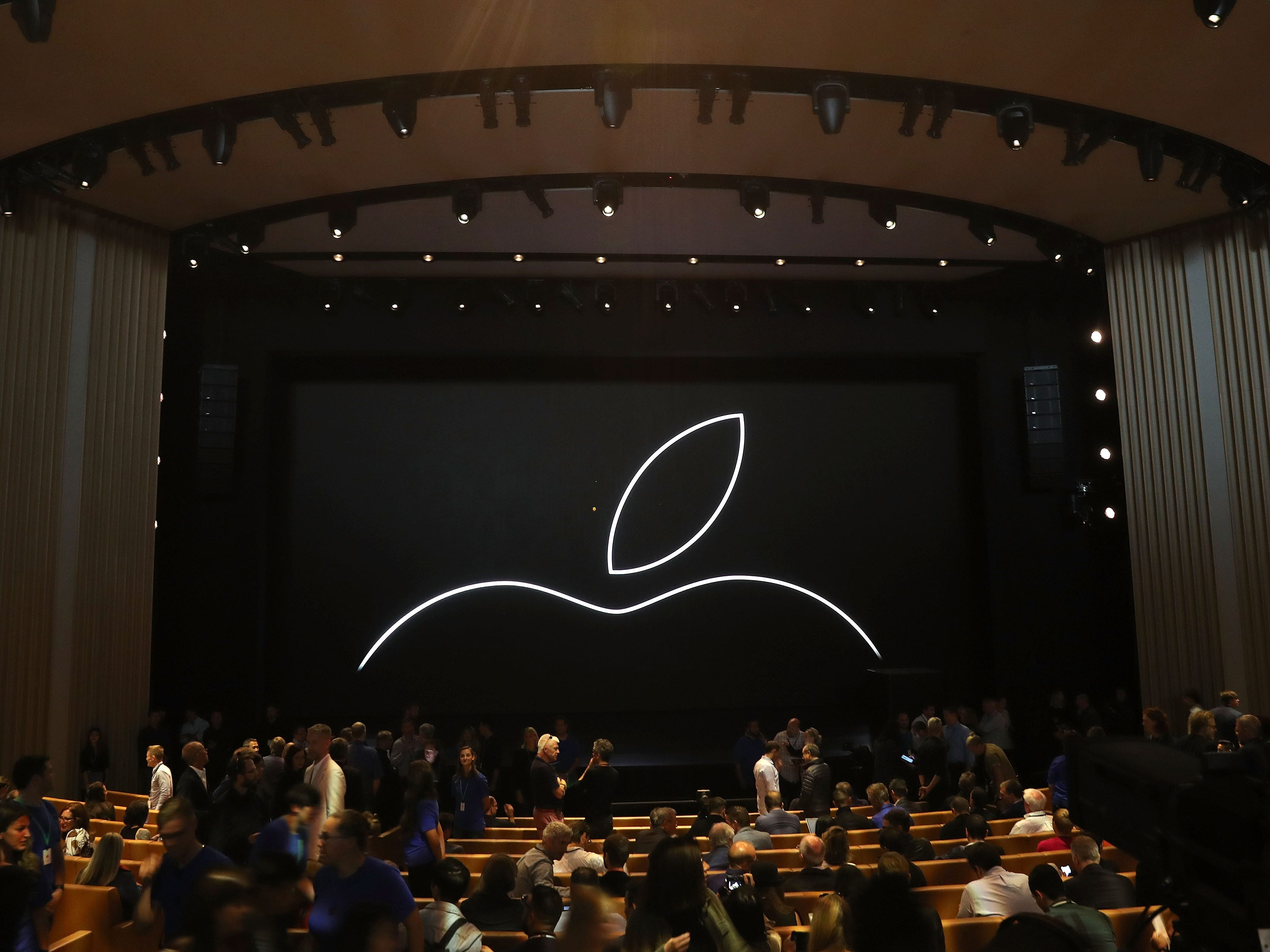 Attendees start to fill in seats prior to an Apple event at the Steve Jobs Theater at Apple Park on Sept.12, 2018 in Cupertino, Calif.