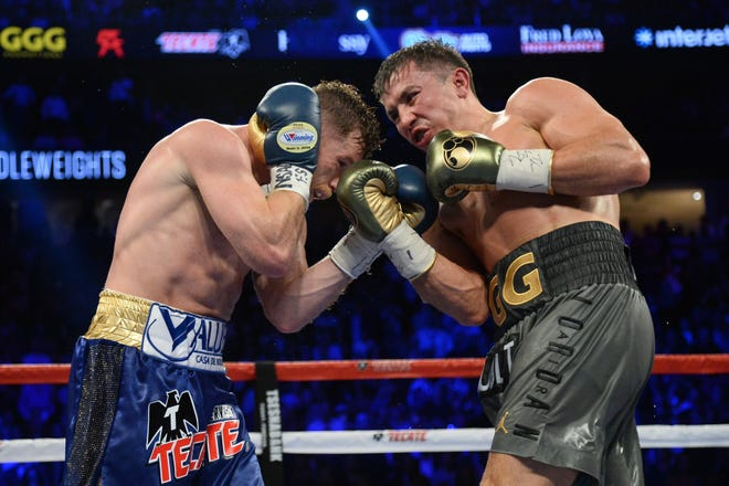 Gennady Golovkin (right) and Canelo Alvarez fought to a draw in Las Vegas last September.