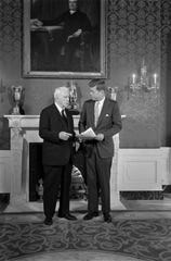 President John F. Kennedy and poet Robert Frost in the Green Room of the White House on Jan. 22, 1961. Frost recited a poem at Kennedy's inauguration.