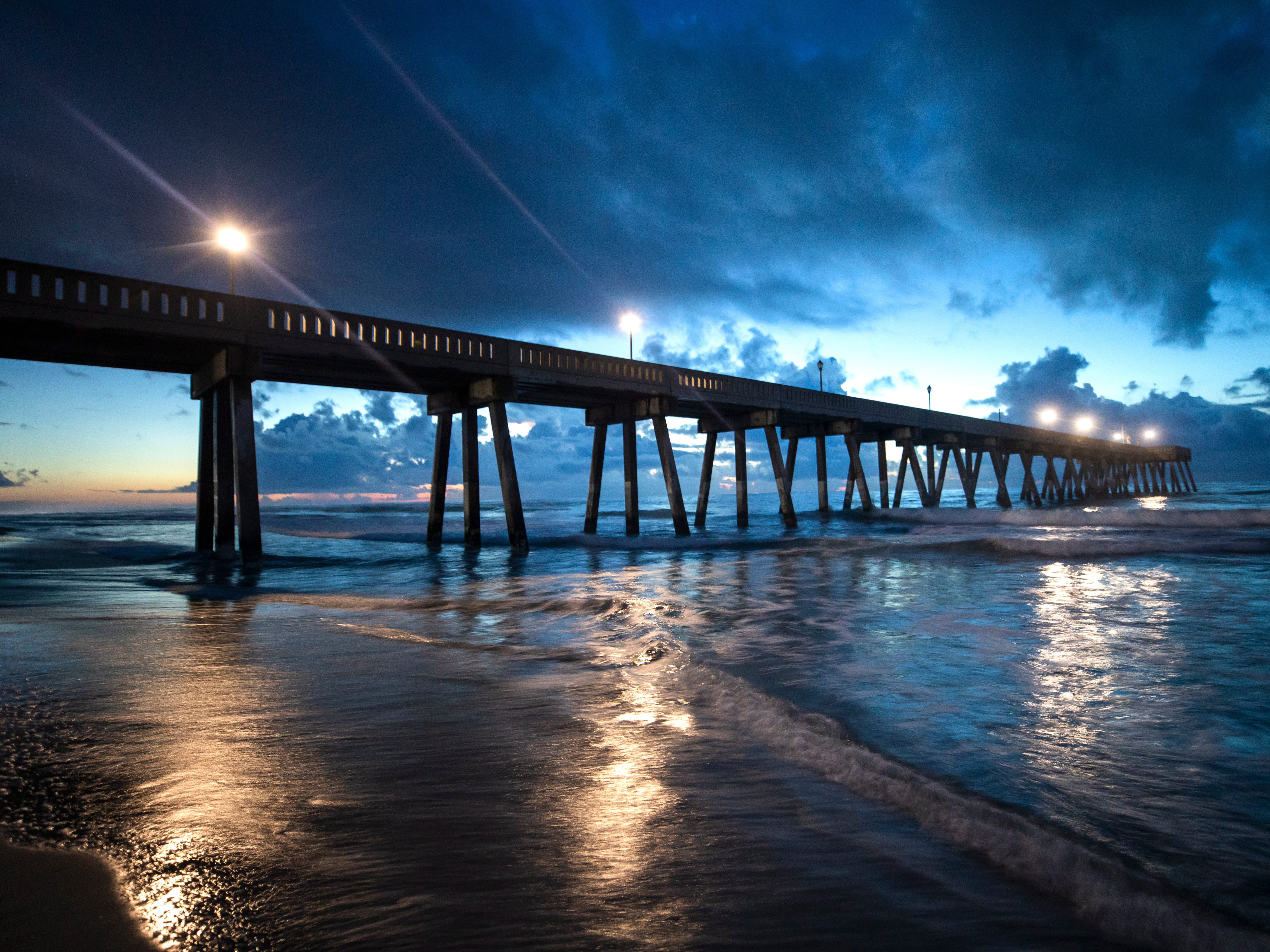epa07014641 Johnny Mercer's Fishing Pier juts into the Atlantic Ocean at sunrise, less than two days before Hurricane Florence is expected to strike Wrightsville Beach, North Carolina, USA, 12 September 2018. Hurricane Florence is a category 4 storm on the Saffir-Simpson Hurricane Wind Scale, with winds toping 165 miles per hour. No category 4 hurricane has ever made landfall in North Carolina.