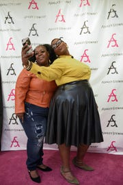 "Rhondesia Jones, left, and Donna Perry, snap a selfie at the Ashley Stewart store in Harlem. The ""social lounge"" is a customer favorite."