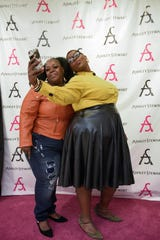 537ffeb8eedd Rhondesia Jones, left, and Donna Perry, snap a selfie at the Ashley Stewart