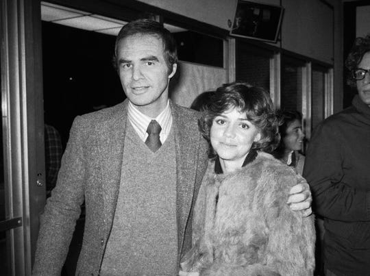 """Burt Reynolds and Sally Field met while they were filming 1977's """"Smokey and the Bandit"""" and began dating. In this Dec. 23, 1978, photo, they attend the off-Broadway play """"Buried Child"""" in New York."""